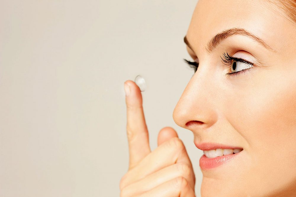 Close up Profile of Woman Putting on Contact Lens
